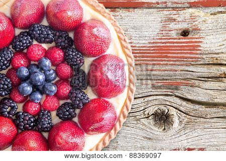 Tart With Fresh Berries On Rustic Wooden Table