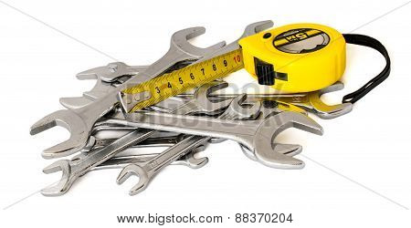 wrenches and tape-measure on a white background