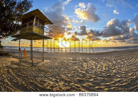 Sunrise over Gold Coast Surfers Paradise beach with lifeguard station