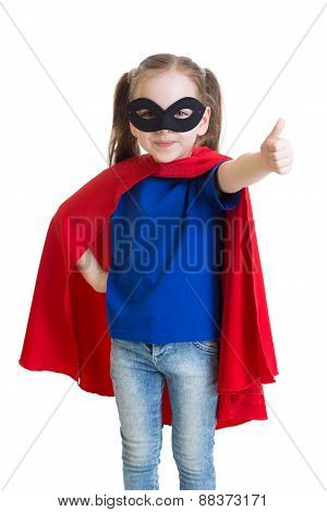 Child shows thumb up pretending to be a superhero
