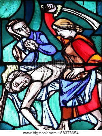 ELLWANGEN, GERMANY - MAY 07: Judith, liberator of her people, kills the enemy captain Holofernes, Stained glass window in Basilica of St. Vitus in Ellwangen, Germany on May 07, 2014.