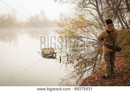 Fisherman on the river . Fisherman in his hand holding spinning.