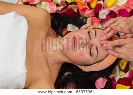 Beautiful woman in salon.Spa therapy for young woman receiving facial mask at beauty salon