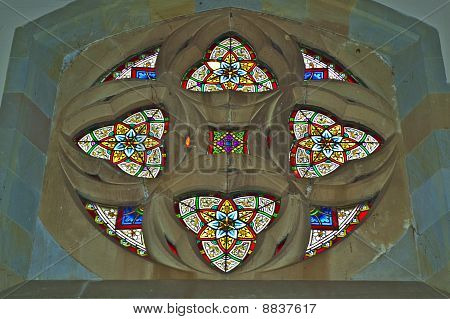 Stained Glass Window set in a Church Wall