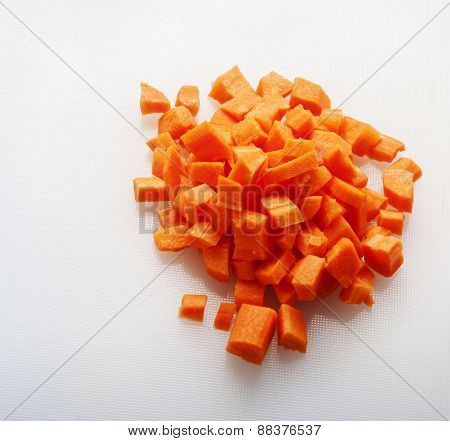 chopped carrots top view close up on white background