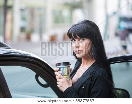 Beautiful Woman Downtown With Coffee