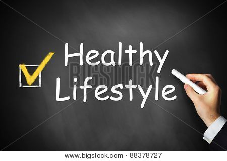 Hand Writing Healthy Lifestyle On Black Chalkboard