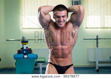 Handsome muscular male body. Male bodybuilder.