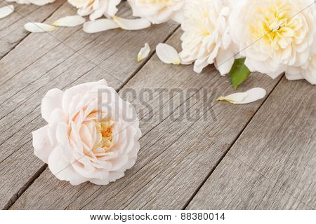 Fresh rose flowers on wooden background with copy space