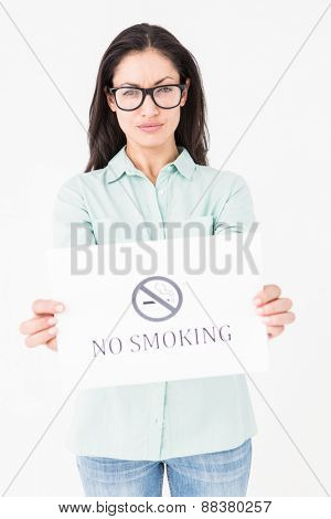 Brunette holding no smoking card on white background