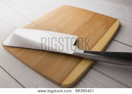 Chopping board with large knife shot in studio