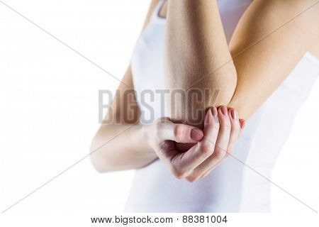 Fit woman with elbow injury on white background