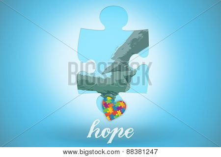 The word hope and elderly couple holding hands against blue background with vignette