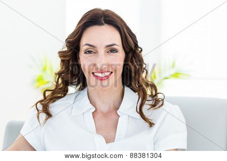 Smiling therapist looking at camera on white background