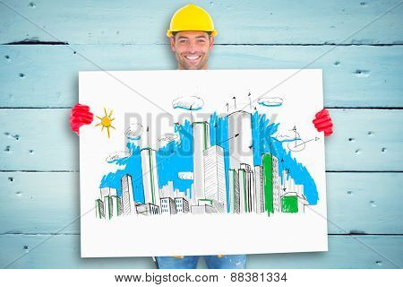 Portrait of handyman showing blank placard against painted blue wooden planks