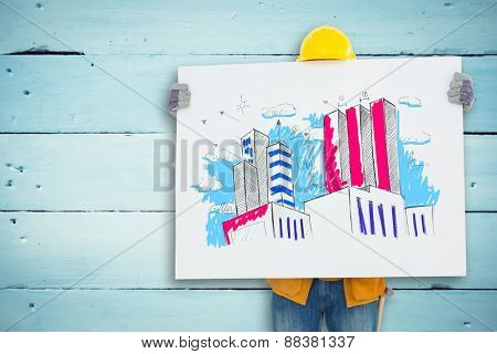 Technicial holding blank billboard against painted blue wooden planks