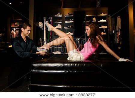 Pair Of Lovers Is Trying On New Shoes