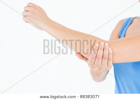 Woman touching her painful elbow on white background