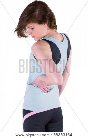 Pretty brunette with back injury on white background