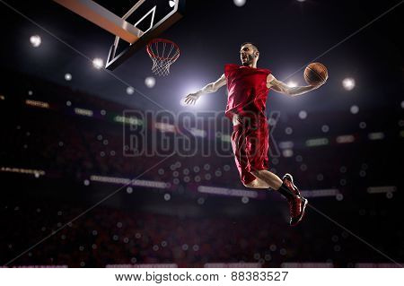 red Basketball player in action