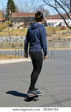 woman riding longboard skateboard outdoor
