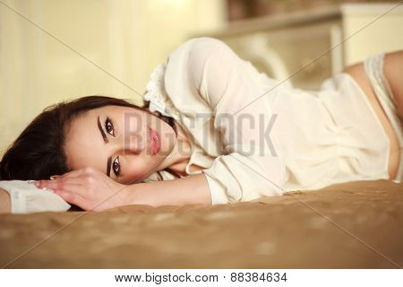 Sensual Young Woman Lying In Bedroom At Home In Sunny Daylight