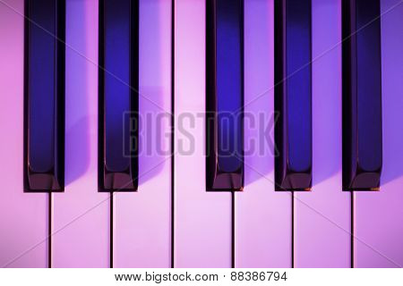 Piano Keys Under Colored Lighting