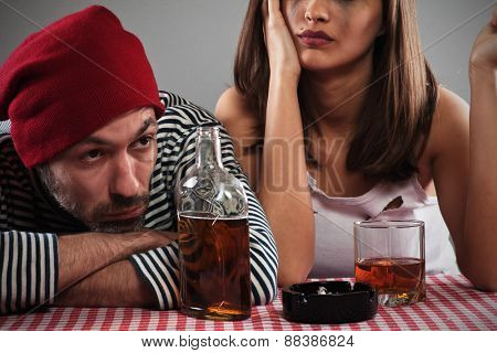 Young couple with drinking issue, falling into depression