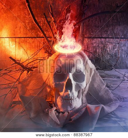 Skull with cloth and fire.