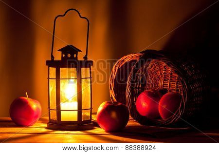 Candle Lantern And Apples