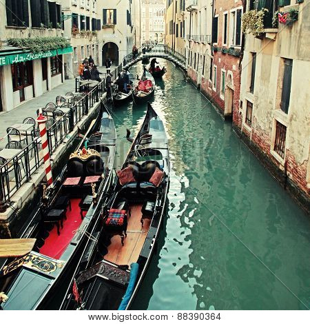 Typical Gondola At Narrow Venetian Canal, Venice, Italy.