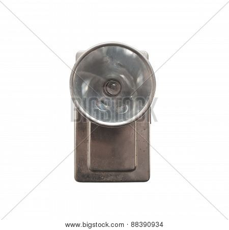 Old flashlight front view.