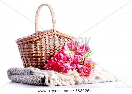 picnic basket full of pink tulips - food and drink