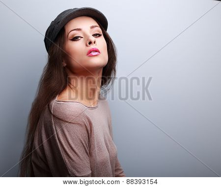 Sexy Makeup Woman In Cap Posing In Modern Blouse