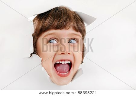 Little Girl Face Through The Paper Hole