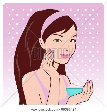 Woman applies moisturizing cream