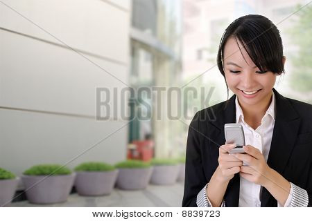 Happy Business Woman Reading Sms