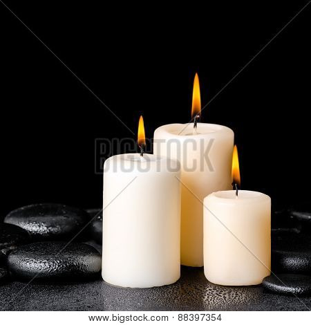 Spa Concept Of White Candles On Zen Basalt Stones With Drops
