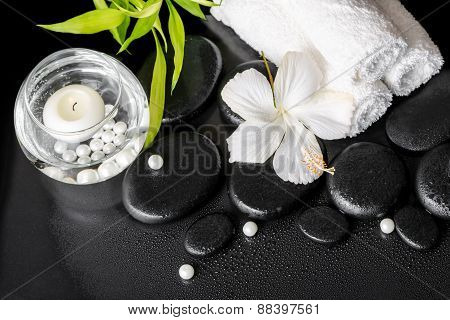 Spa Still Life Of White Hibiscus Flower, Bamboo, Round Vase With Beads And Towels On Zen Basalt Ston