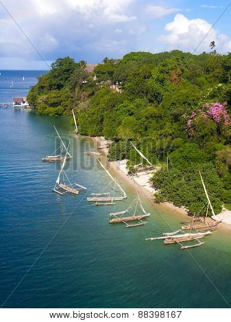 Tropical beach line with sailing boats