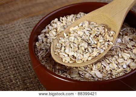 Oatmeal Brown Plate And Wooden Spoon