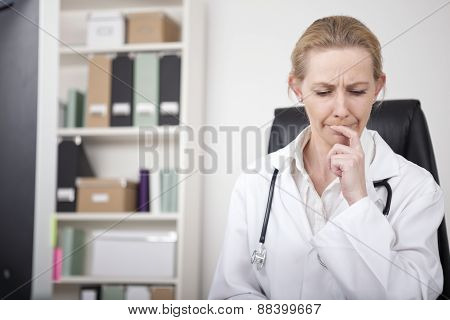 Thoughtful Female Doctor Putting Finger On Lips