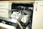 picture of dishwasher  - details of Open dishwasher with clean utensils - JPG