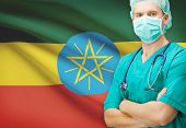foto of ethiopia  - Surgeon with national flag on background  - JPG