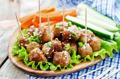 stock photo of sesame seed  - meatballs with Teriyaki sauce and sesame seeds on a white wood background - JPG