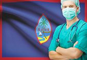 picture of guam  - Surgeon with national flag on background  - JPG