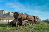 pic of locomotive  - Large old steam locomotive which for years waiting for repair and Museum. ** Note: Visible grain at 100%, best at smaller sizes - JPG