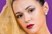 pic of gold  - Girl with a professional makeup posing on a purple background - JPG