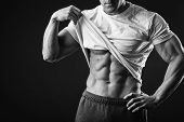 pic of abdominal muscle man  - Muscular man bodybuilder - JPG