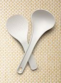 foto of ladle  - White spatula and ladle on the cloth background - JPG